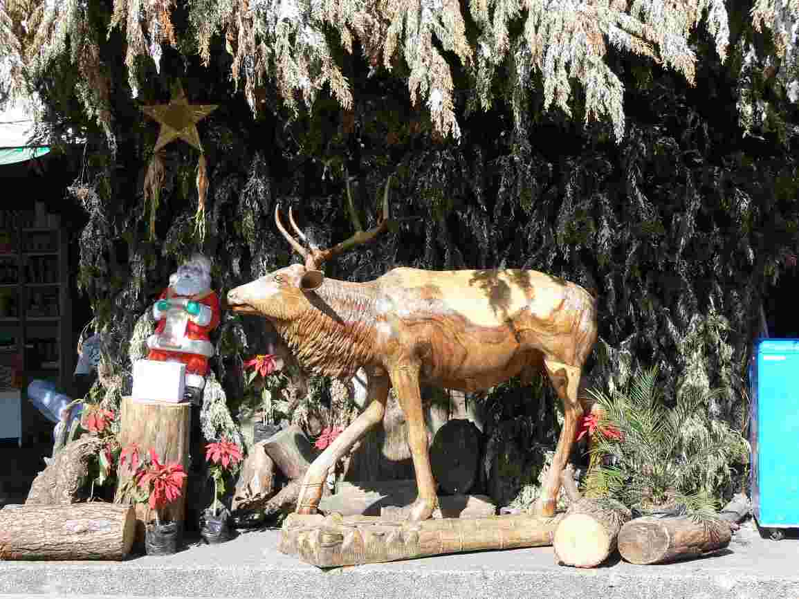 Wood carving of a stag at the Mines View market, Baguio City, Philippines